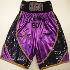 John Quigley custom made wet look boxing shorts and sleeveless ring jacket with gold trim, made by suzi wong creations design your own
